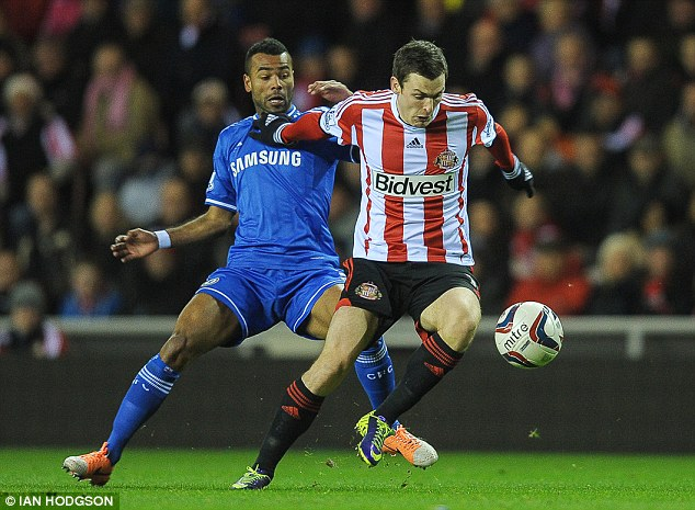 England battle: Ashley Cole and Adam Johnson tussle on the Sunderland's left wing