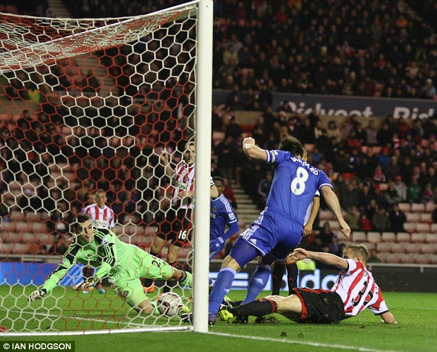 Ahead: A combination of Frank Lampard and Lee Cattermole bundle the ball into the Sunderland goal