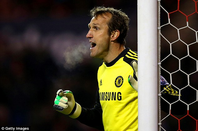 Rare outing: Mark Schwarzer shouts at his defence through the cold evening