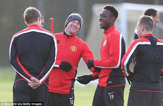 Follow the leader: Danny Welbeck has been told to copy Wayne Rooney's work ethic
