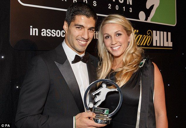 Prize fighter: Suarez (with his wife Sofia Balbi) was named Football Supporters¿ Federation Player of the Year
