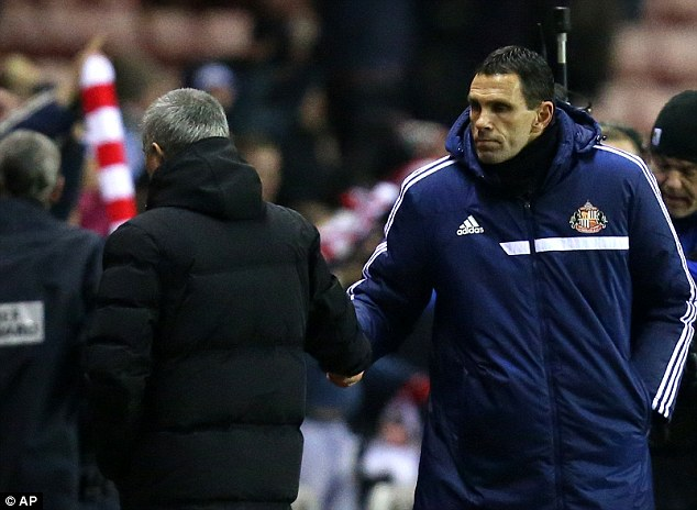 Quickly away: Mourinho givese a swift handshake to Gus Poyet before leaving the pitch
