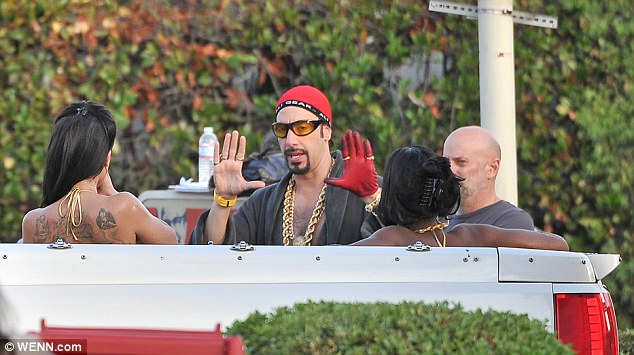 Centre of attention: Cohen shoots a scene as Ali G in the rear of a pick-up truck