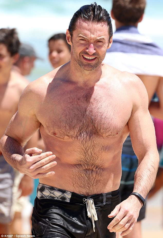 Bondi boy! Hugh emerges from the surf at the beach in Sydney