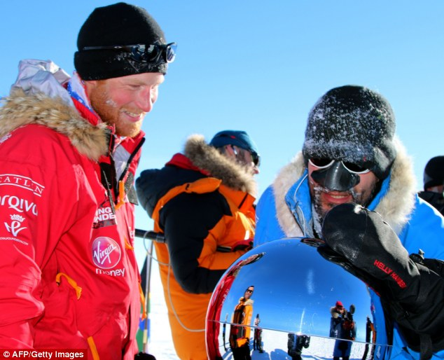 Harry Smiles: The bearded royal and US team member Ivan Castro, a serviceman who lost his sight on duty, touching the pole as they reach their goal on December 13
