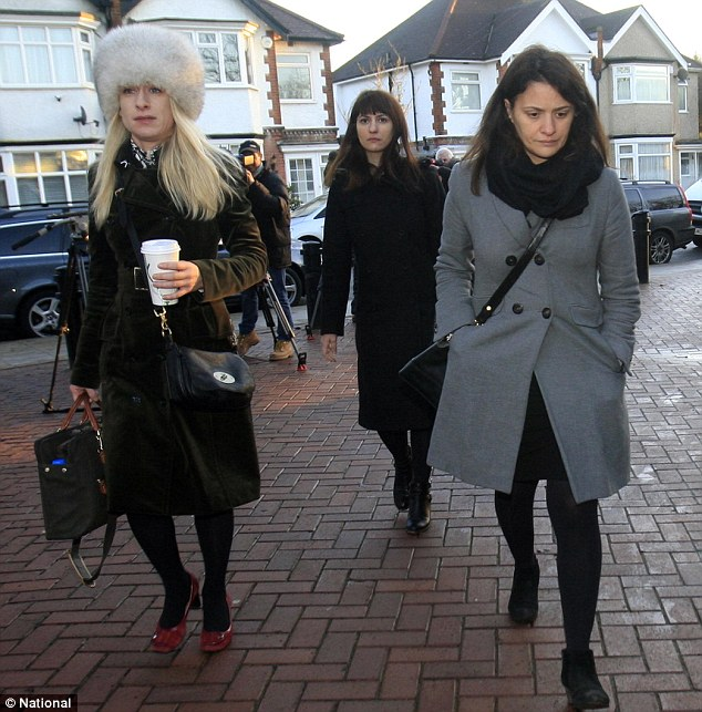 Accused: Elisabetta Grillo (right), her sister Francesca (back) and a member of their legal team arrive at Isleworth Crown Court yesterday