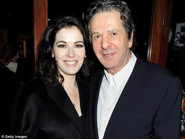 Marital strife: The defence suggested Nigella Lawson could not tell her ex-husband Charles Saatchi about her drug-taking because of the way he would react - so approved the sisters' spending