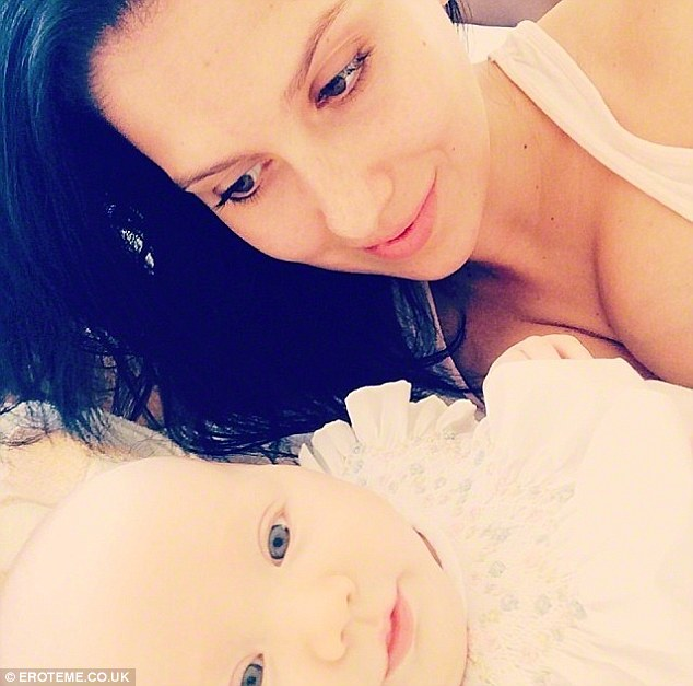 Adoring mother: Hilaria is seen gazing adoringly at daughter Carmen, born August 23, in this Instagram picture