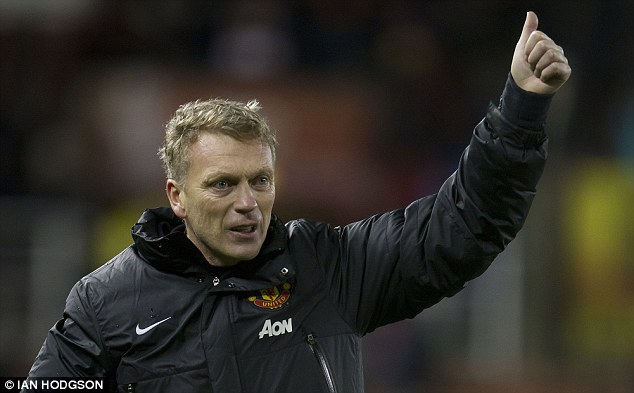 Thumbs up: David Moyes salutes fans after United defeat Stoke in the Capital One Cup