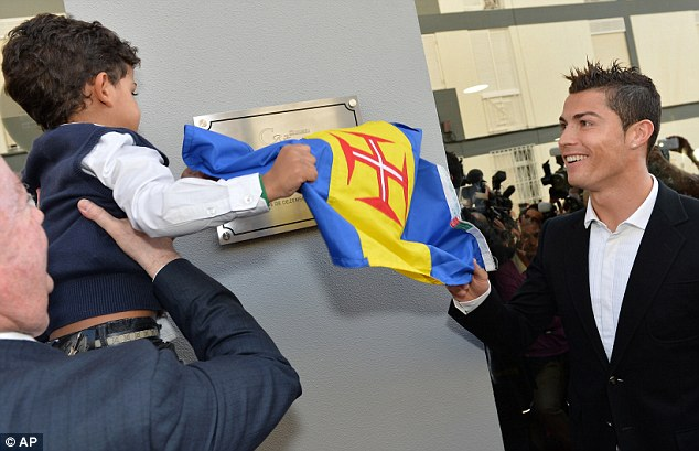 Helping daddy: Cristiano Junior helps unveil the museum dedicated to his famous father