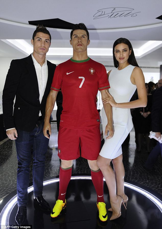 Double vision: Irina Shayk poses next to a waxwork model of Ronaldo, next to the real thing