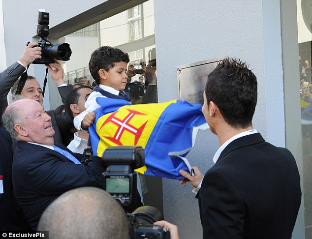 Proud: Cristiano Ronaldo's three-year-old son, Cristiano Junior, helped unveil a museum plaque dedicated to his father