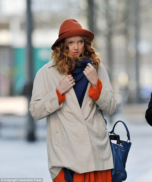 Wrapping up: Lily Cole shields herself from the cold in Manchester