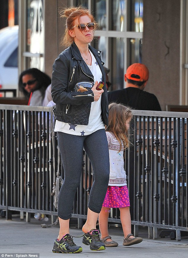 Day out: While Sacha filmed, wife Isla Fisher enjoyed a day out with their daughter Elula in West Hollywood