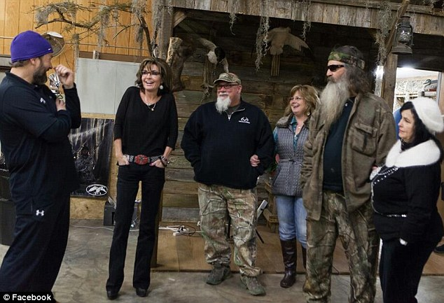 Sarah Palin, pictured with the Duck Dynasty cast while on her book tour in Louisiana. The former governor and her daughter, Bristol, have defended Robertson