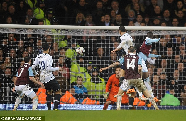 Winner, winner: Madibo Maiga heads home West Ham's second goal to seal their place in the last four