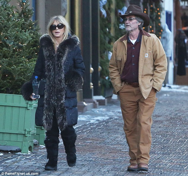 Strolling: The actress finished off her look with a pair of knee-high snow boots, perfect for the weather