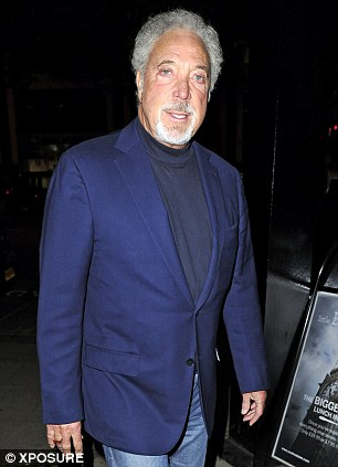 Dapper man: Singer Tom Jones looked groovy in his blue suit jacket and jeans