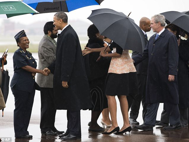 Entourage: In addition to the first lady, Obama brought along former President George W. Bush, former Secretary of State Hillary Clinton, and other dignitaries