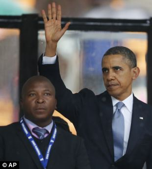 Spitting distance: Thamsanqa Jantjie, the mentally unbalanced and violent phony sign-language interpreter, got close enough to President Obama to do him harm