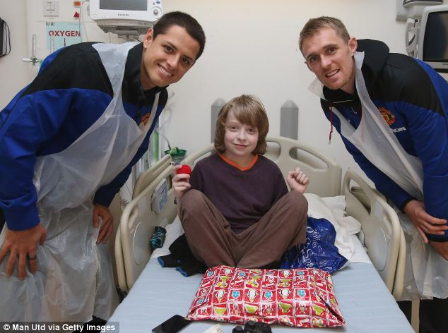 Privilege: Fletcher said it was a great honour to visit the children and bring them presents this Christmas