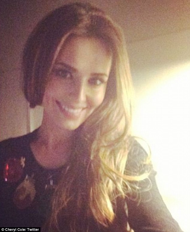 Tasteful: Cheryl Cole also shared a picture of herself wearing a jumper with Christmas baubles on it