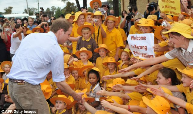 Baby George's father has visited both countries several times: Above, William, on tour of Australia in 2011, greets students in Kerang, Victoria after the area was hit by floods