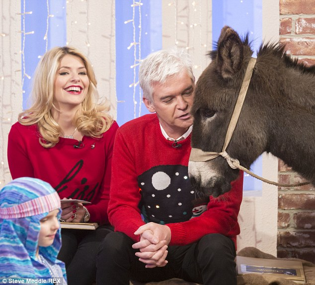 Christmas giggles! Holly finds it all a laugh on the set of the last show for the year