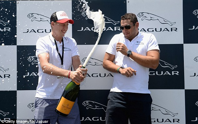 Reeling: Bresnan (right) is sprayed by Root with the champagne