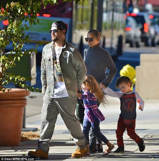 Young family: Nicole strolls with her husband Joel Madden, daughter Harlow and son Sparrow