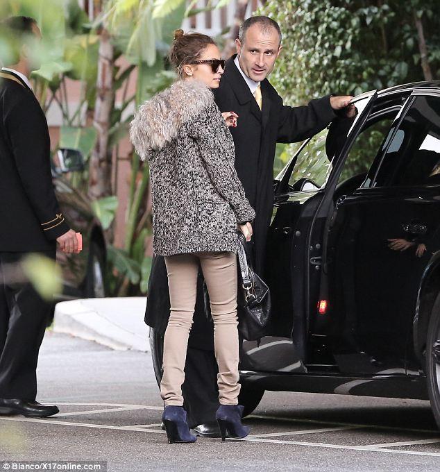 Eye-catching: Nicole's winter cardigan featured a statement fur hood