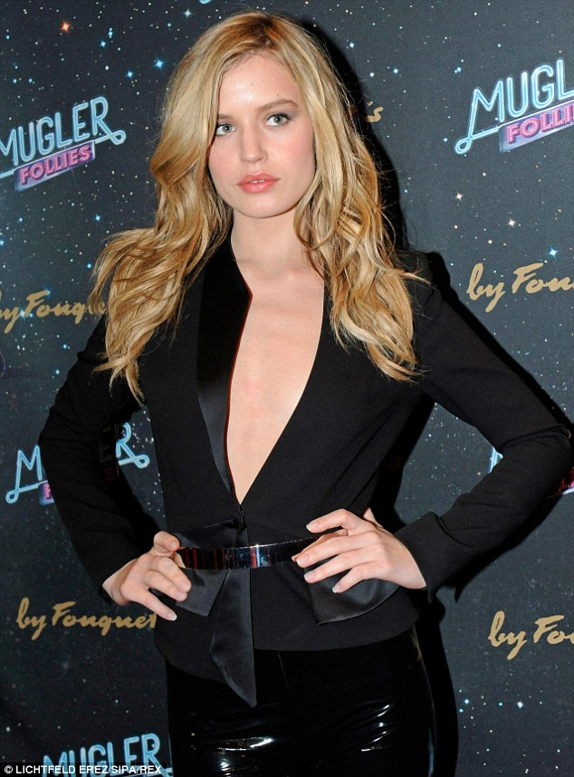 That pout! The model flashed her chest in a plunging tuxedo jacket on arrival at the Comedia Theater
