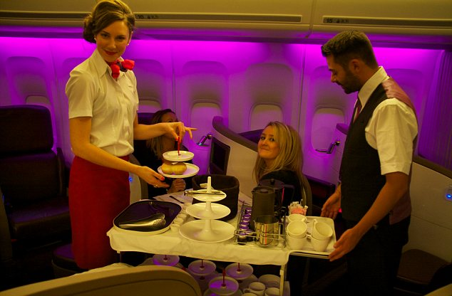 Image counts: Jenny learns how to serve afternoon tea while keeping that hair-do in position