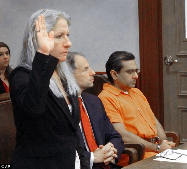 A mother's grief: Lori Ballman, mother of slaying victim Deanna Ballman, is sworn in before giving a victim impact testimony at the sentencing of ex-Ohio doctor Ali Salim, far right
