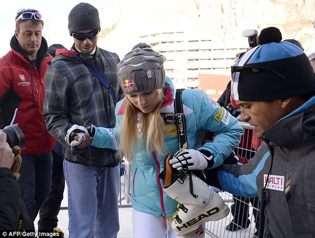 'Bummed about today': Olympic skier Lindsey Vonn crashed while defending her title at the women's World Cup downhill in Val d'Isere, despite having Woods there cheering her on