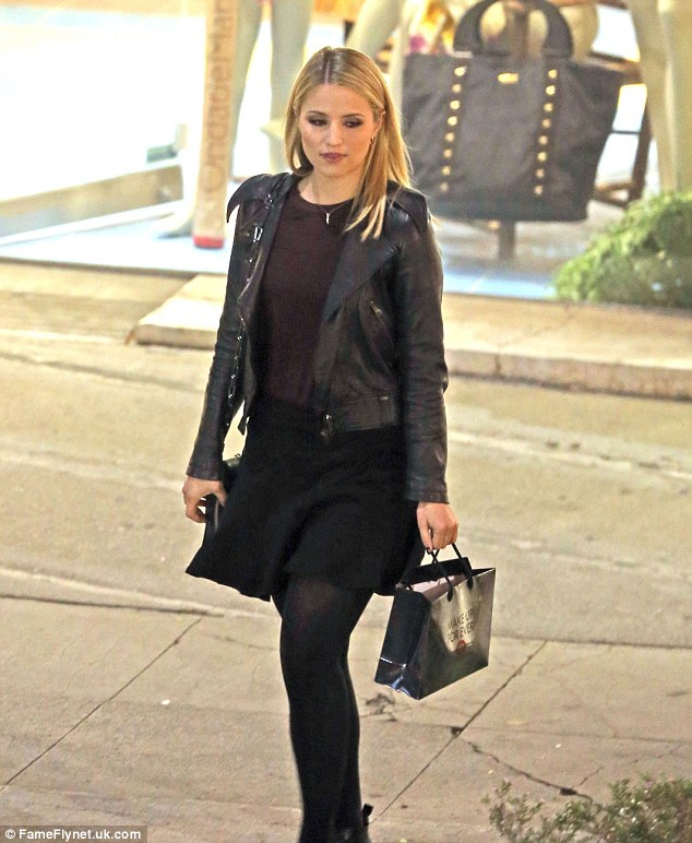 Happy shopper: Dianna obviously liked what she saw - she left with a packed gift bag
