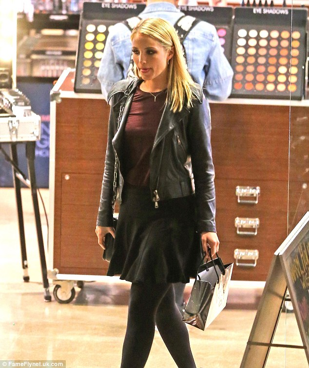Gleeful: actress Dianna Agron tries out some beauty new products while shopping in LA