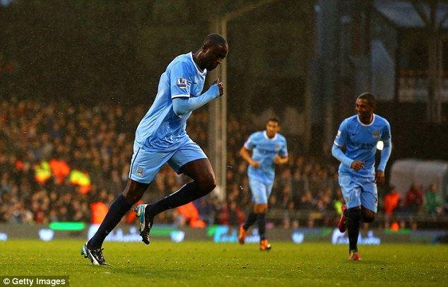 Ahead: Yaya Toure's sublime free-kick gave Manchester City the lead in the first half