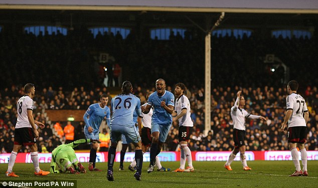 Captain's strike: Kompany have the visitors a 2-0 lead just before half-time