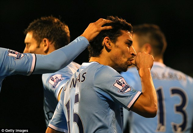 Saviour: Jesus Navas scored a late goal to help Manchester City to a victory against Fulham at Craven Cottage