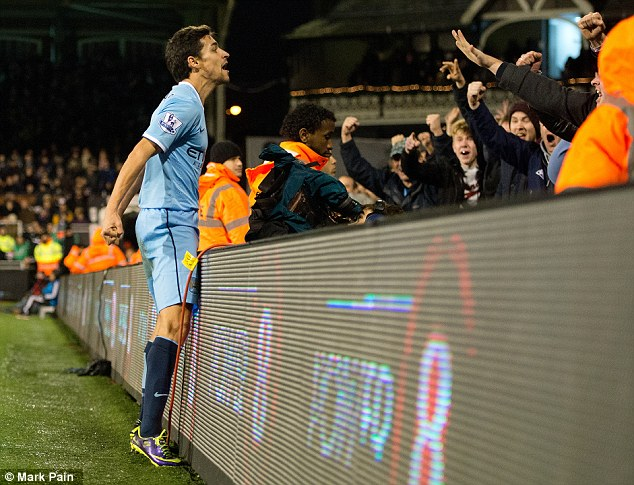 Delight: Navas celebrates after giving Manchester City the lead again with 12 minutes to play