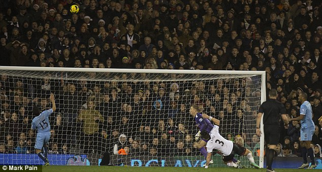Loop: Kompany sliced his clearance from a low cross and saw his shot nestle in the far corner