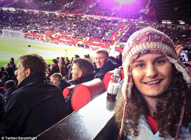 Deja vu: Moyes is caught in the shot as hammer thrower Sarah Holt takes a photo of her sister at Old Trafford
