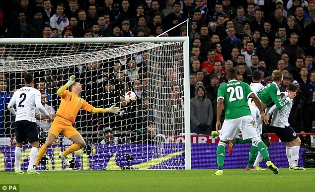 Holding back the tide: Joe Hart, pictured here making a save for England against Germany, came through the youth ranks at Football League side Shrewsbury Town