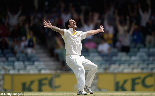 Delight: Mitchell Johnson celebrates taking the final wicket in the game which decided the Ashes