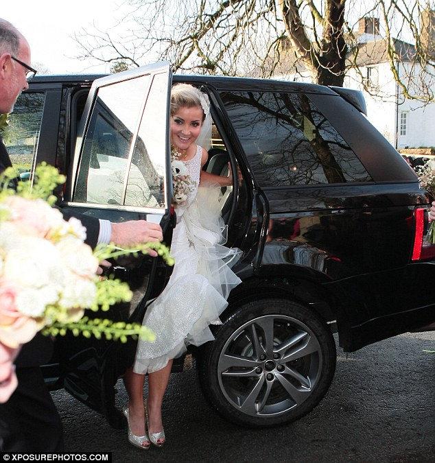 The wedding car: The star arrived in an understated black Range Rover