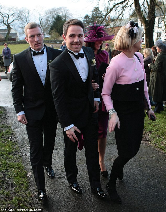 Lucky man: Richie smiled as he made his way into the church alongside friends and family members