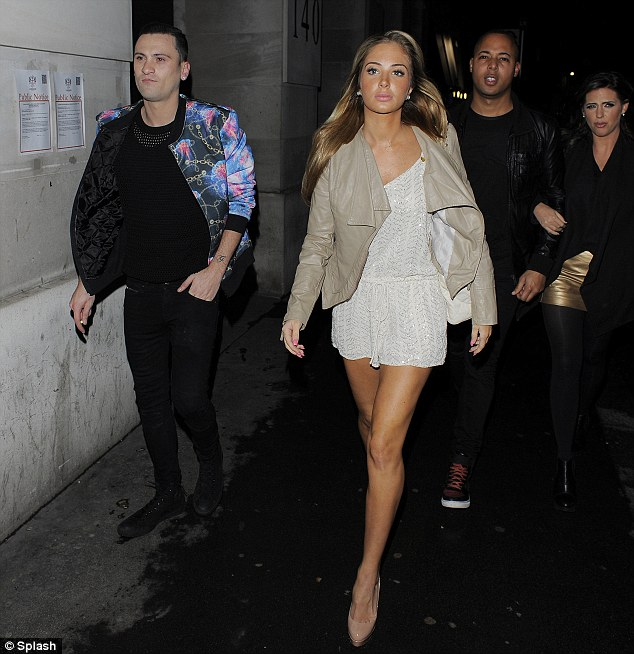 Forgetting her troubles: Tulisa finished off her look with a pair of nude heels and matching leather jacket
