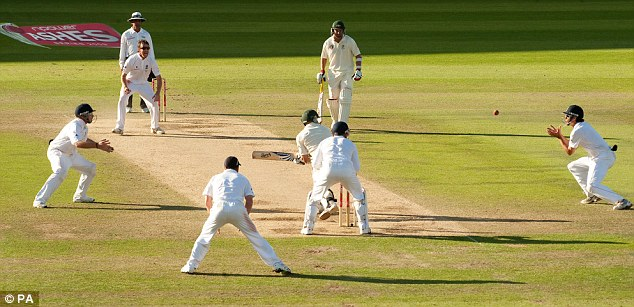 Drama: England's Alastair Cook (right) catches out Australia's Michael Hussey from the bowling of Graeme Swann