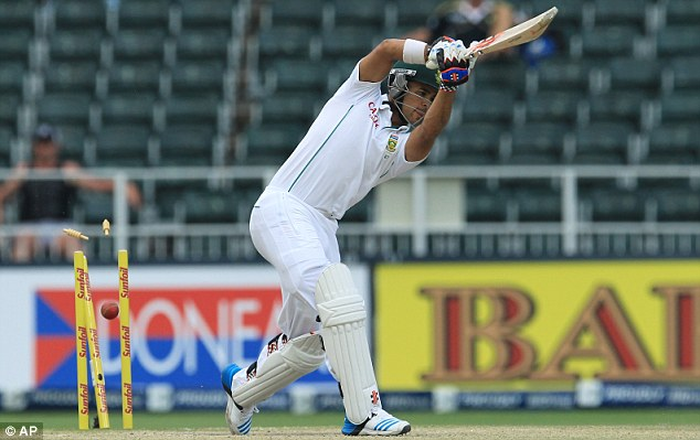 Bowled him: Duminy is bowled for 5 runs during the final day of the Test